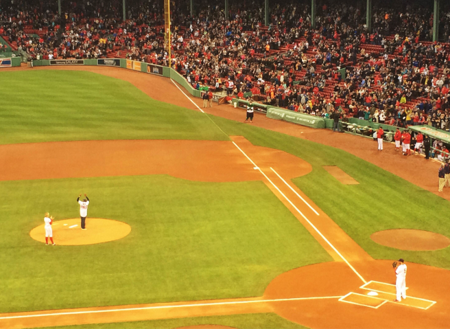 Meb Keflezighi, Men's winner of the 2014 Boston marathon, threw out the first pitch.