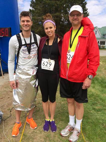Jon, me, and my dad after finishing the race...and recovering for a bit.